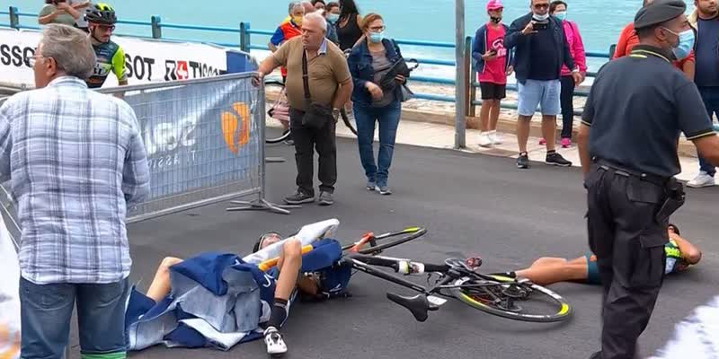 Cyclist-suffers-suspected-BROKEN-BACK-after-low-flying-helicopter-causes-barrier-to-strike-two-riders-at-Giro-d-Italia